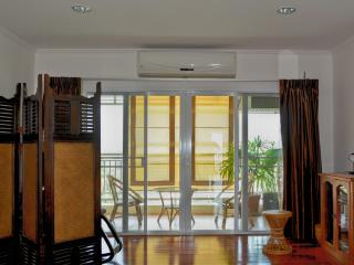 balcony with fan and curtains