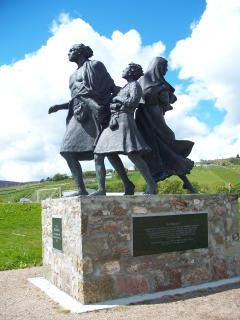 A bronze statue to those that were ethnically cleansed forcing repatriation to US, Canada Australia.