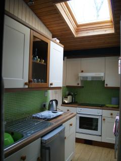 kitchen has large velux window making kitchen space very bright