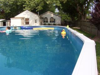 The above ground pool provides fun for the whole family right in the back yard