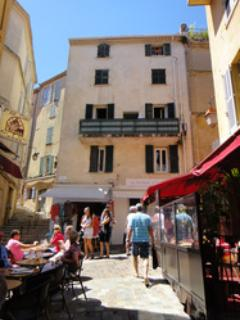 The studio is located at the end of rue Meynadier, top floor of this historical 18 century building