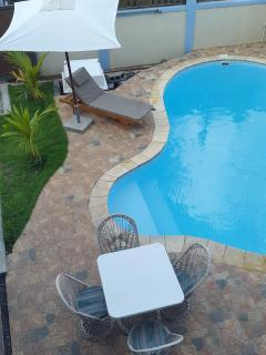 The amazing private pool and the relaxing chair for sun bath.