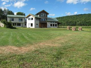 This view shows the  Bunkhouse (on left)  added to make 6 BR, 3 Full/2 Half baths + 2 dens