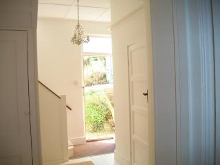 The hall looking through the front door to the garden