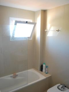 Large bathroom with natural light.