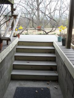 Four steps up to the new walk and deck