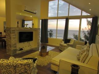 The living room provides amazing views with floor to ceiling windows or you can relax watching TV