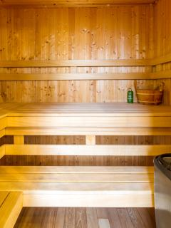 Bathroom near the first bedroom has spacious jacuzzi and private sauna made from cedar wood.