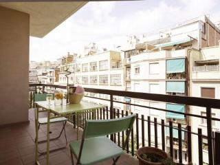 Panoramic city views near Sagrada Familia from 3BR/1BA with private balcony.