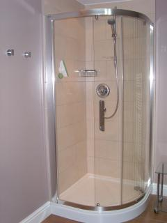 The separate shower cubicle with pumped shower