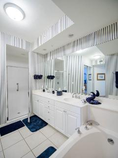 Master Bathroom with double sink, tub and shower