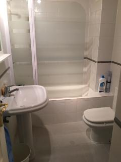 En suite bathroom to main bedroom. Bath with overhead shower