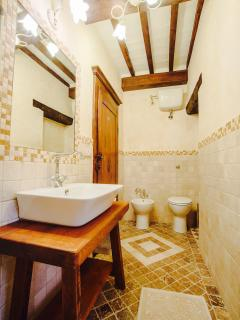 "Bathroom in the ""travertine"" tuscan style. In an elegant and high quality design."