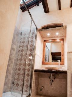 Bathroom lit by the skylight to insure a relaxing and wonderfull shower, with all sorts of comforts.