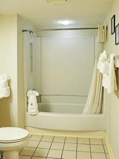 This generously sized bathroom has plenty of room to get ready for each thrilling day