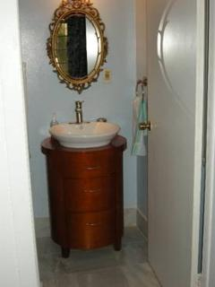 Half bathroom is conveniently located off of the large bedroom in the duplex