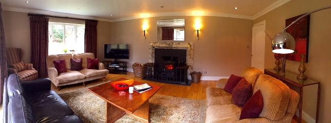 Sitting room with the wood burning stove lit.