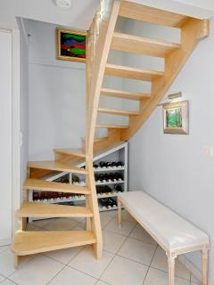 Custom made staircase leads to master suite