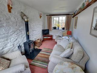 The cosy sitting room has a woodburning stove