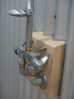 The shower fixture...rustic is good!