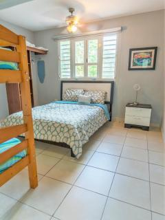 Second bedroom with queen size bed and twin bunk bed