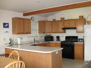 Large open kitchen/dining area with fully equipped kitchen