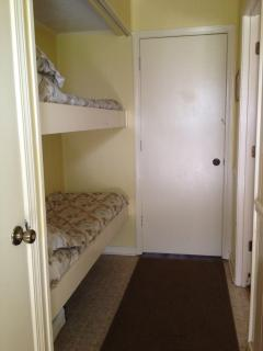 Hallway with bunk beds.