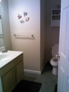 Hall bathroom, full bath room with tub.
