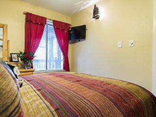 Master queen bedroom downstairs with HD Netflix TV and very comfortable bed