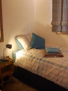 Cosy twin bedroom with 2 adult size single beds to keep everyone comfortable