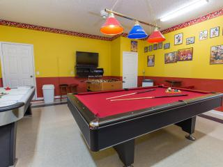 Pool table, air-hockey, foosball table and flat-screen TV