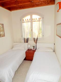 Bright and comfortable  twin bedroom with views
