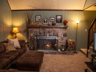 Relax in the great room with a comfy sofa and wood-burning fireplace.