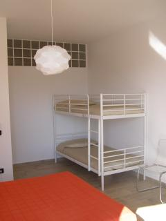 secondary bedroom with double bed and bunk bed