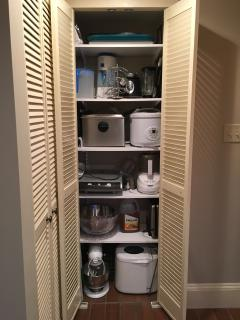 Kitchen gadgets in closet off the sitting room
