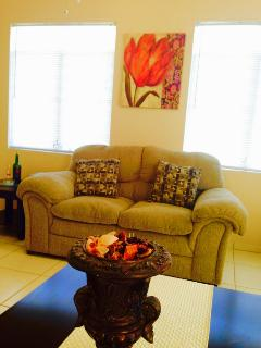 Big couch, love seat in a spacious living room, end tables, contemporary decor! WiFi free of charge