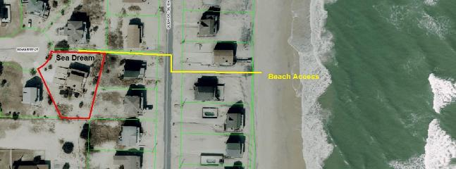 Beach access is directly adjacent to the house