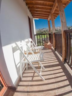 Upstairs bedrooms balcony with view to the almond trees and vine yards