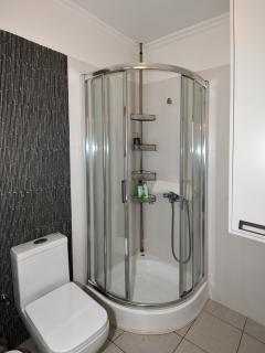 Bathroom with Washing Machine and Shower cabin