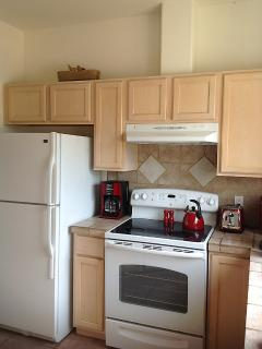 Fully equipped kitchen with all red accents.