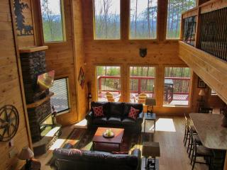 Large 2 story open Great Room with stacked stone fireplace, 2 sofas &panoramic views of Mt. LeConte!