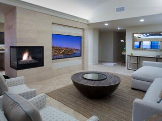 Villa Laguna Living Room Features a Fireplace and Giant Flat Screen TV