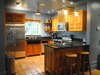 Gourmet Kitchen: gas range, microwave, copper cookware, nonstick cookware, full range of appliances