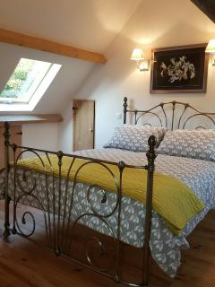 The light and airy bedroom  with views over the garden at back and countryside to front, yet private