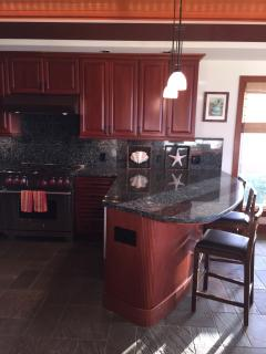 Poipu Vacation Home:  3 bedroom, AC, pool.  Comfortable and easy bar seating.