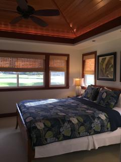Upper King Suite: raised, inlaid wood plantation-style ceiling, soffit light.