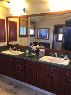 Upper Master Bath: double oversize sinks, stone floors, walk-in closet/dressing.