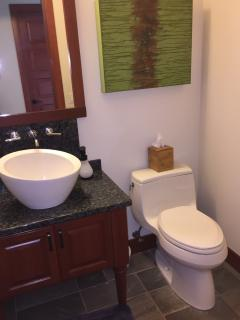 Poipu Vacation Home: Elegant half-bath off of upper living area.