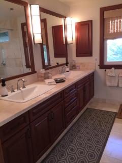 Lower Master Suite Bath:  double oversize sinks, dressing area, walk-in closet.