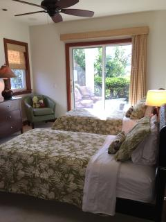 Lower Twin bedroom:  Luxury bedding, glass doors lead to covered lanai and pool.